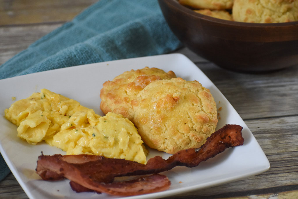 low carb keto biscuits with eggs and bacon on a plate