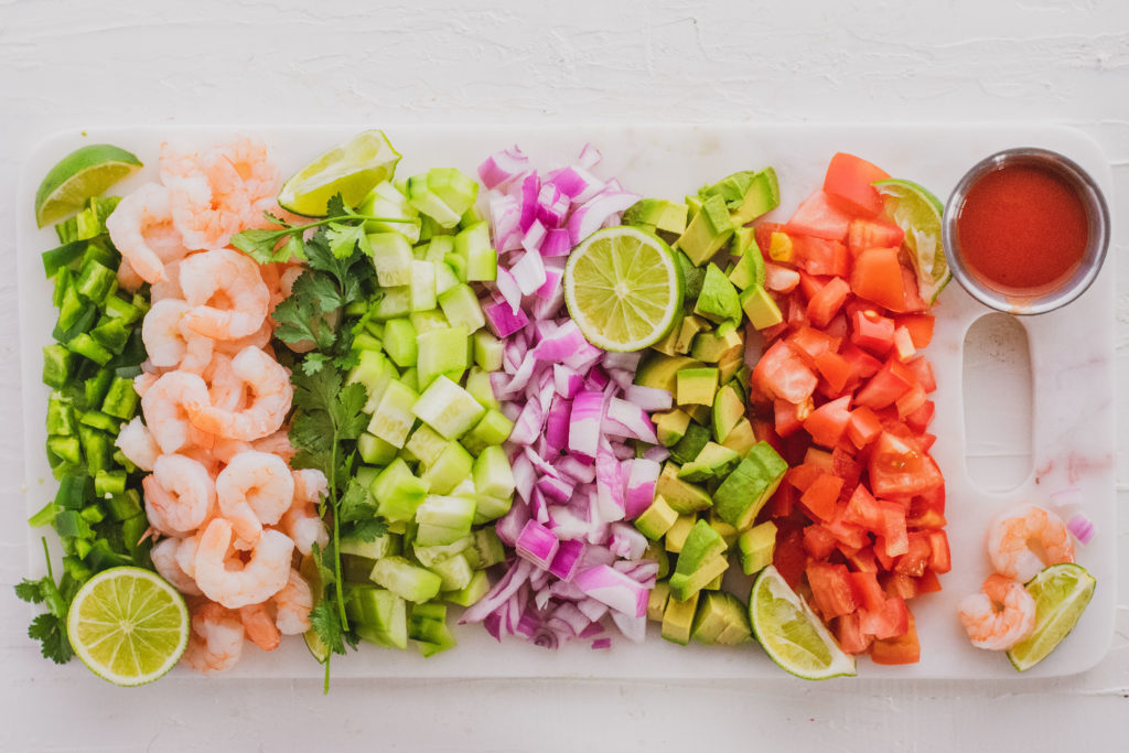 Ceviche ingredients chopped on a white surface