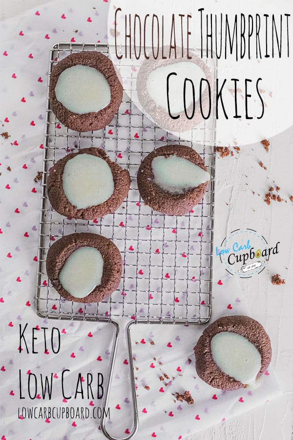 Keto Chocolate Thumbprint Cookies with white chocolate ganache in the middle! These are the perfect low carb Valentine's Day cookies. #ketocookies #lowcarbcookies #chocolatecookies