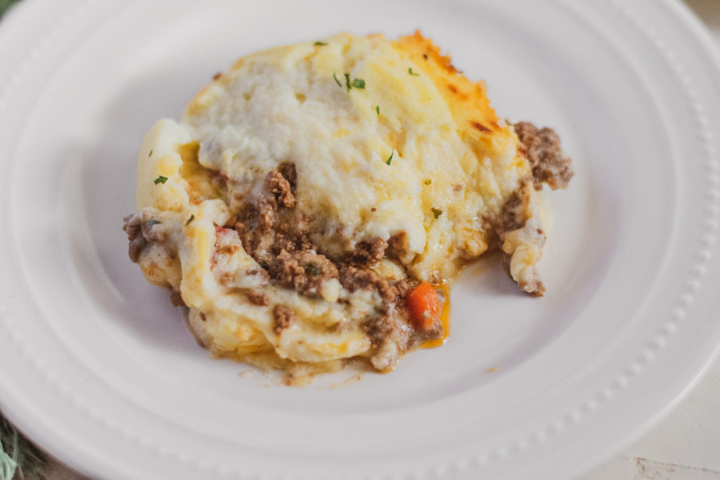 Low carb shepherd's pie serving on a white plate.