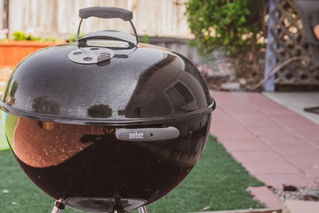 Weber Grill in a backyard.