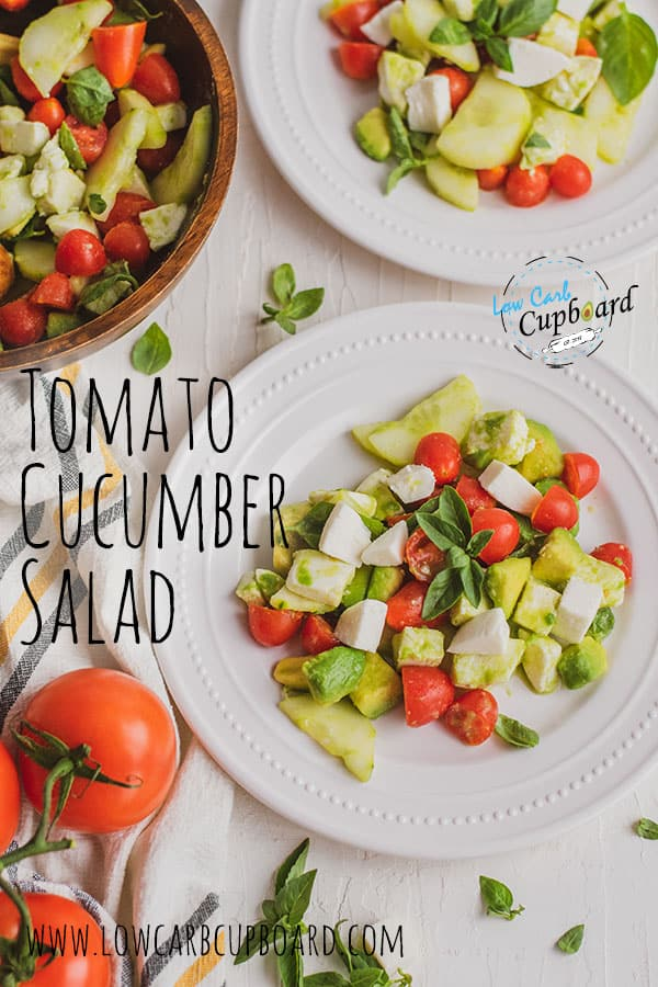 Super easy to make keto Tomato Cucumber Salad recipe. Made with healthy fats, fresh veggies and herbs with creamy mozzarella and avocado! #ketosalad #ketotomatocucumbersalad
