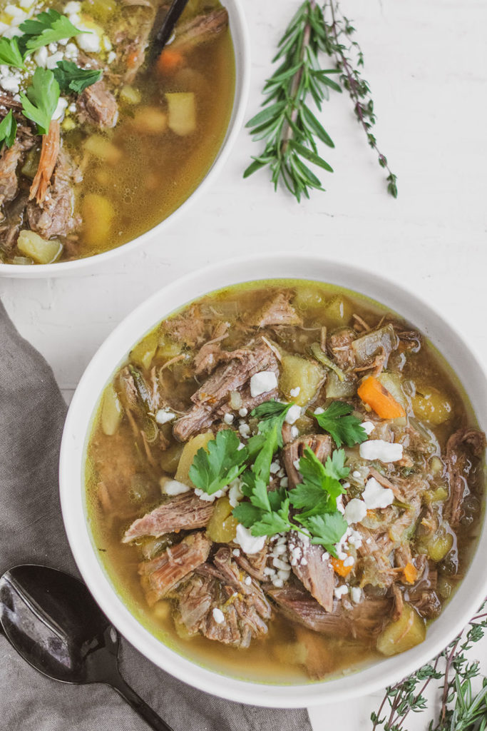 Keto Instant Pot Pot Roast in a white bowl with cilantro on top