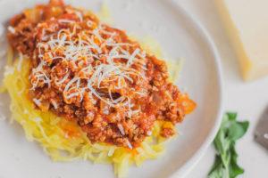 Keto Spaghetti Squash on white plates on a white surface